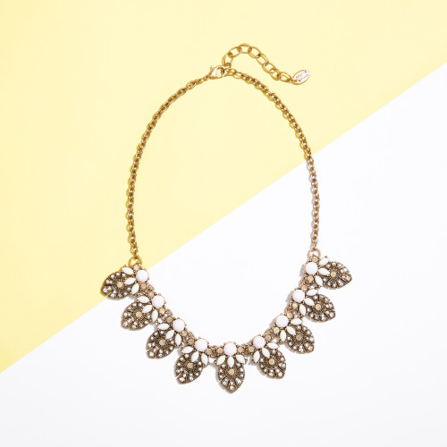 wedding guest outfits: statement necklace