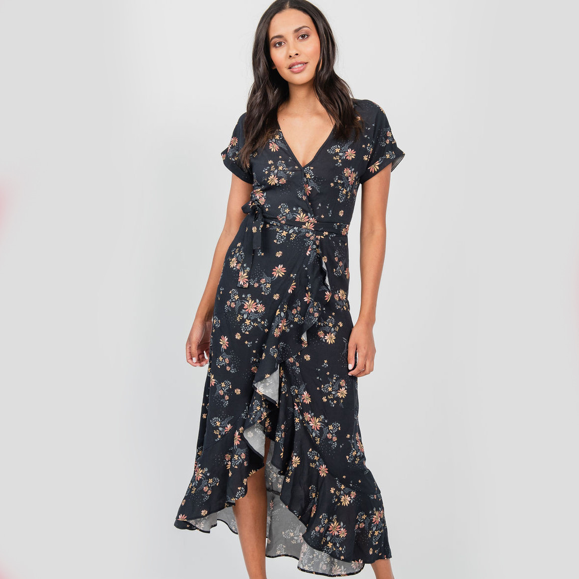 Woman in a Black Floral Wrap Dress - Live and Let Live Casual Summer Dress