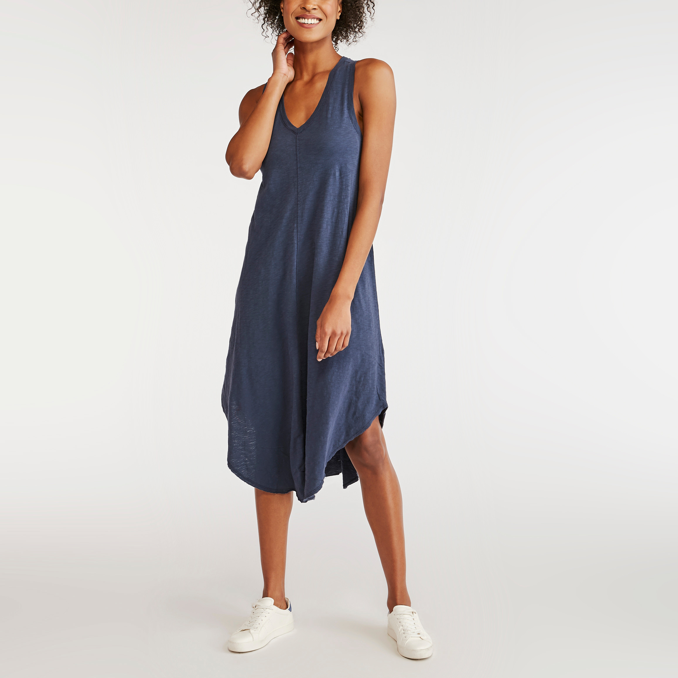 Woman in a greyish blue midi dress and white sneakers - Z-Supply casual summer dress