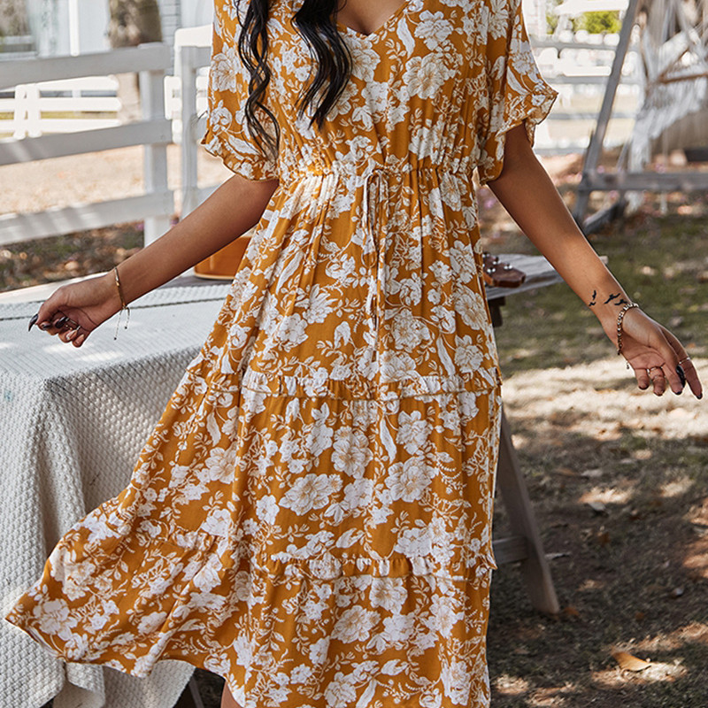 Woman in a sunhat and orange floral midi dress. Casual summer dress by Mountain Valley Trading