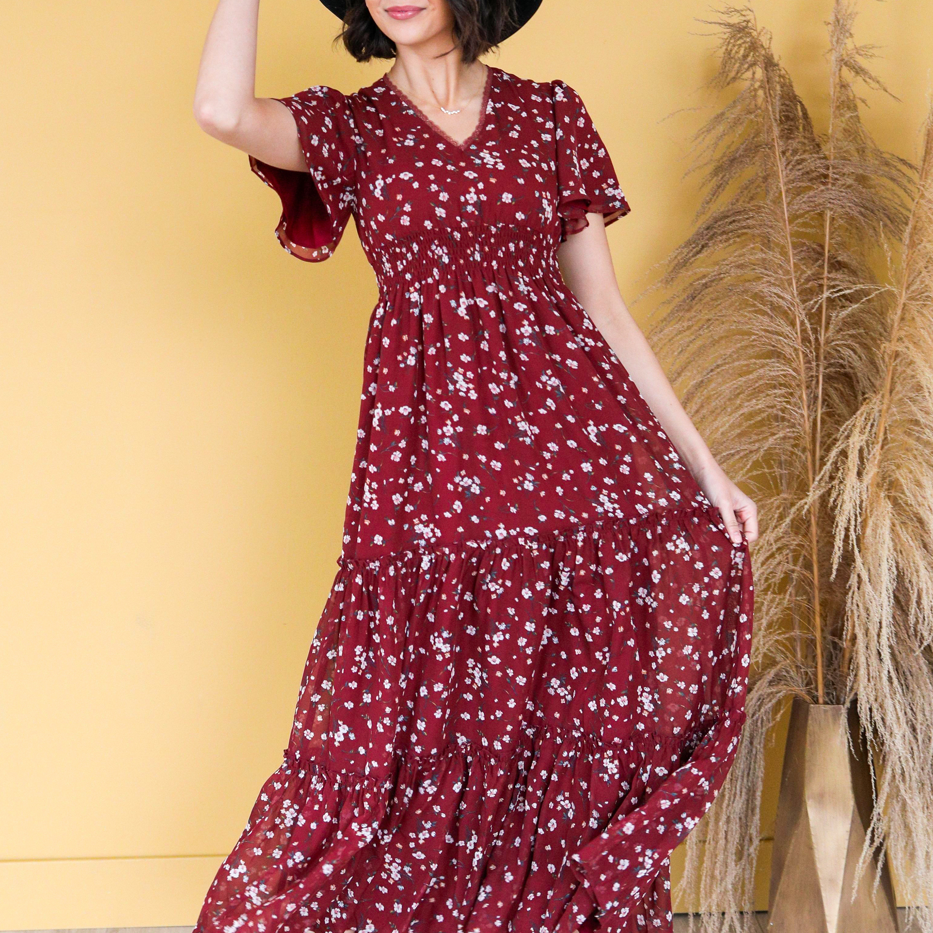 Woman in flowy red maxi dress - Mikarose casual summer dress
