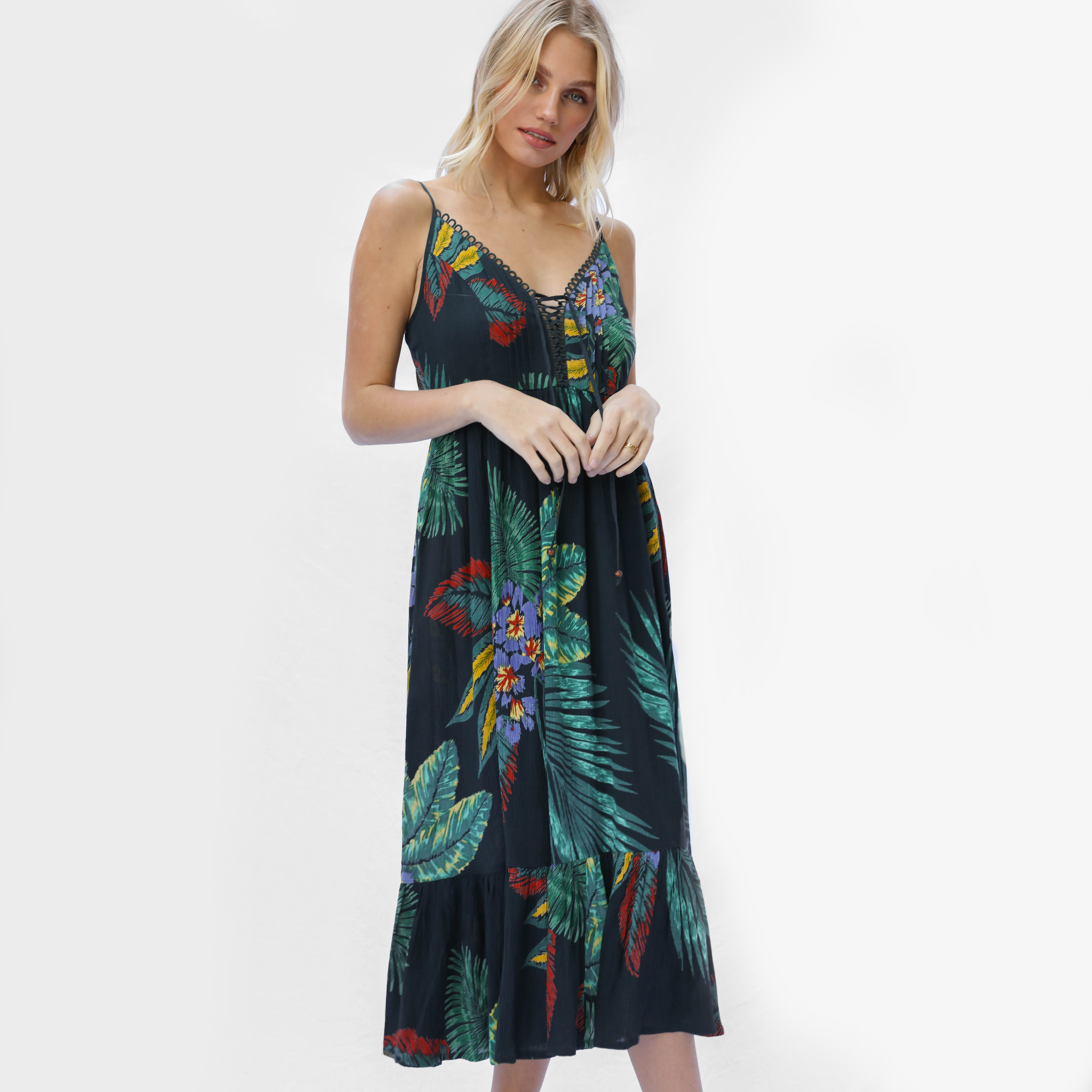 Woman in strappy midi dress with tropical print - Patrons of Peace Casual Summer Dress