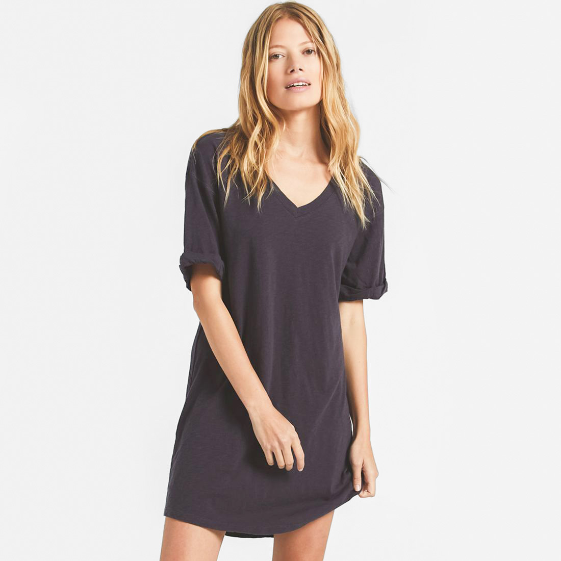 Woman in a black v-neck t-shirt dress by Z-supply - Casual summer dress subscription
