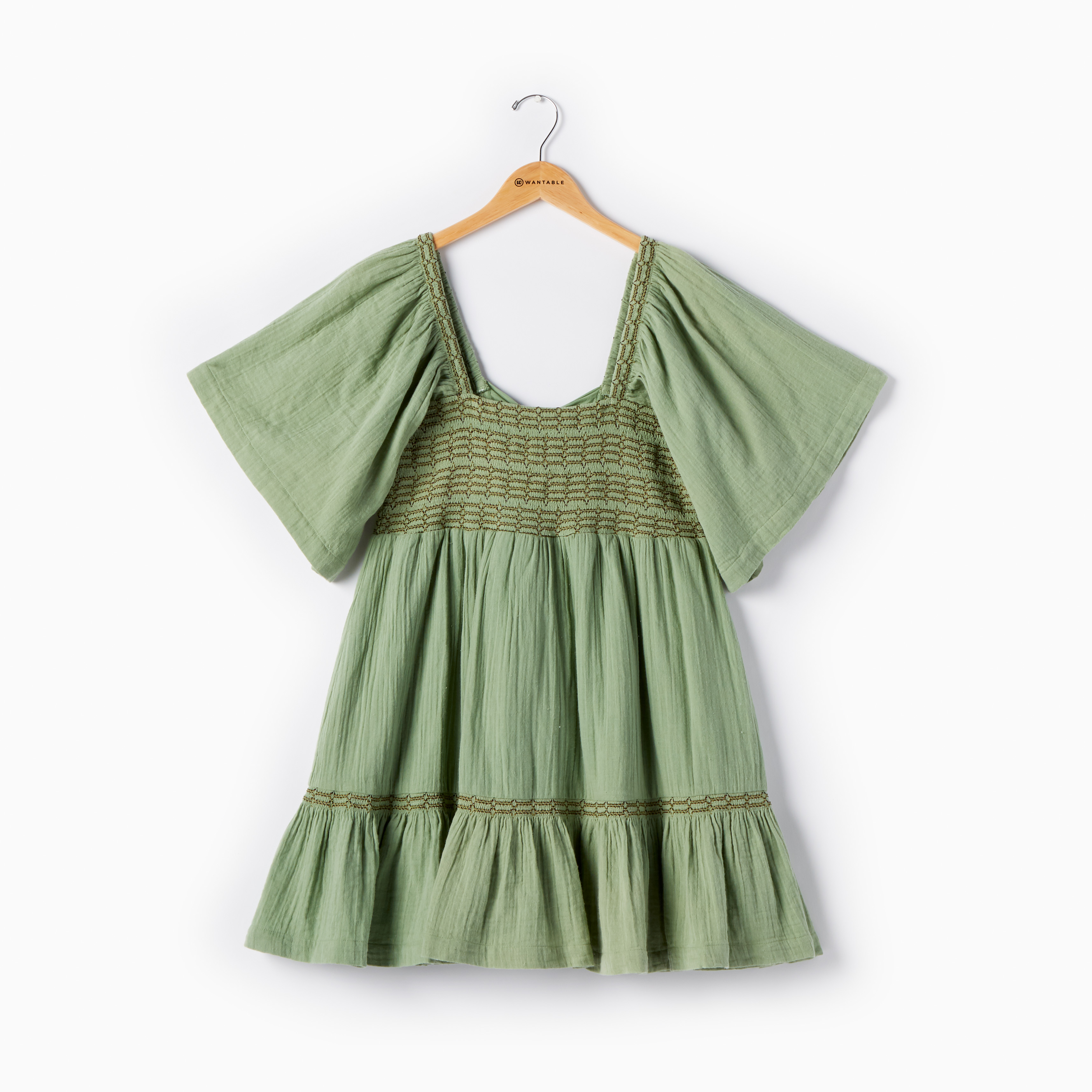 Green Free People bubble dress on a hanger- Women's Style Subscription